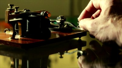 stock-footage-shallow-dof-of-a-telegraph-sending-morse-code